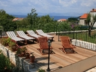 Luxury stone villa on Brac - private terrace with loungers