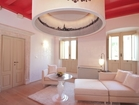 Residence Venice - a living room with a large chandelier in special design